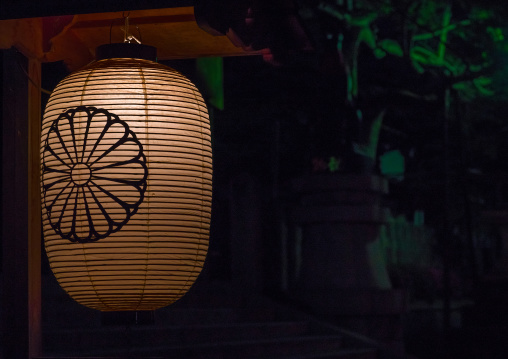A traditional japanese lantern at fushimi inari shrine, Kansai region, Kyoto, Japan