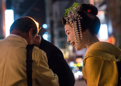Geisha with business men in the streets of gion, Kansai region, Kyoto, Japan