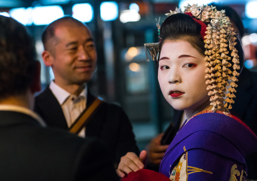 Geisha with businessmen in the streets of gion, Kansai region, Kyoto, Japan