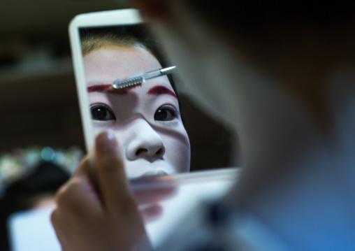 16 Years old maiko called chikasaya during a make up session, Kansai region, Kyoto, Japan