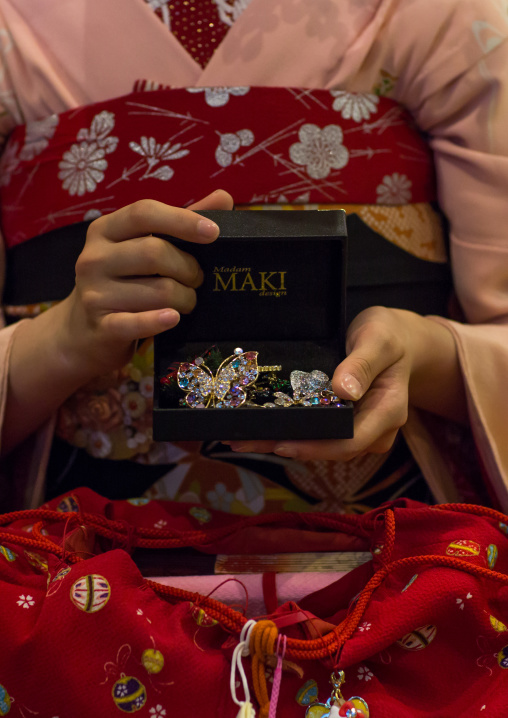 16 Years old maiko called chikasaya showing her brooches, Kansai region, Kyoto, Japan