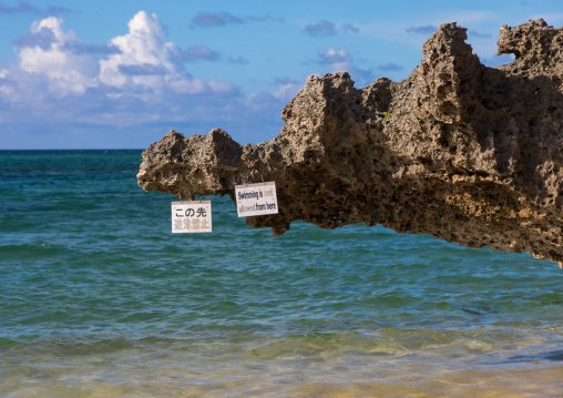 No swimming billboard in sunset beach, Yaeyama Islands, Ishigaki, Japan