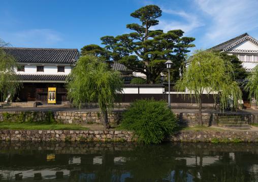 Old houses along the riverbank in Bikan historical quarter, Okayama Prefecture, Kurashiki, Japan