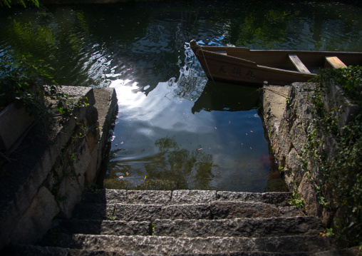 Boat moored at riverbank, Okayama Prefecture, Kurashiki, Japan