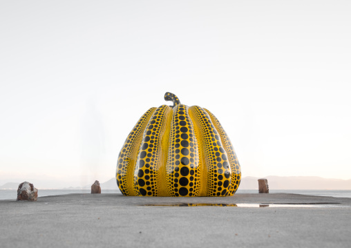 Yellow pumpkin by Yayoi Kusama on pier at sea, Seto Inland Sea, Naoshima, Japan