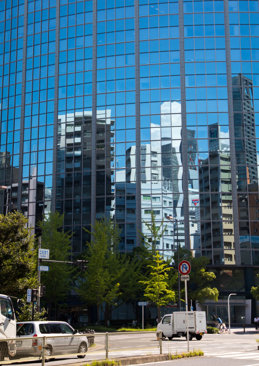 Glass building with reflections on the windows, Kansai region, Osaka, Japan
