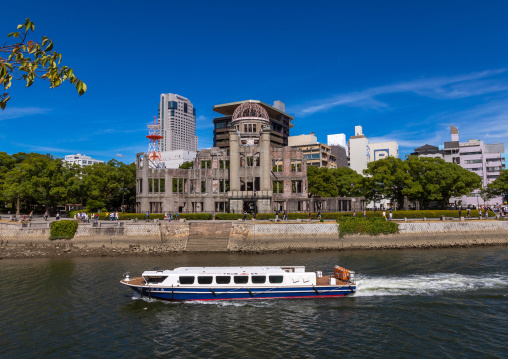 Ferry boat in ota river in front of the Genbaku dome in Hiroshima peace memorial park, Chugoku region, Hiroshima, Japan