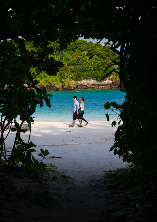 Japanese couple wandering on Kabira bay, Yaeyama Islands, Ishigaki-jima, Japan