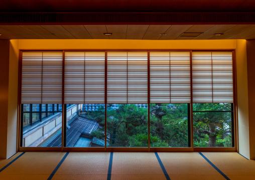 The view of japanese garden from a room in Kinjhoro ryokan, Ishikawa Prefecture, Kanazawa, Japan