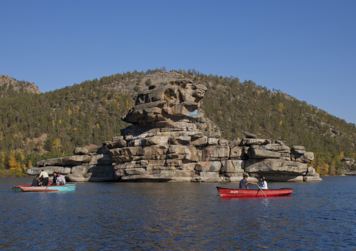 Tourists With Small Boats Around The Lady Rock In Burabay Lake, Kazakhstan
