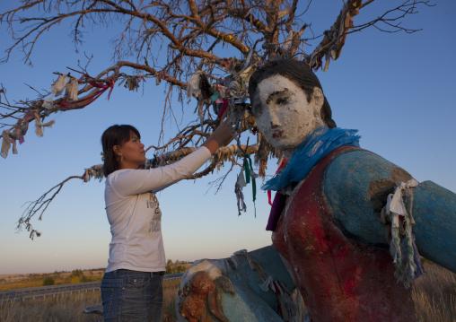 Woman Posting A Wish On A Tree On The Way To Burabay, Kazakhstan