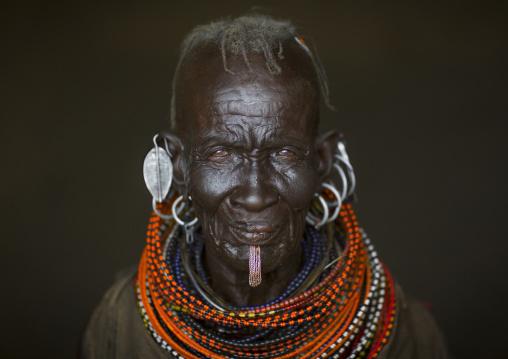 Old turkana tribe woman with huge necklaces and earrings, Turkana lake, Loiyangalani, Kenya