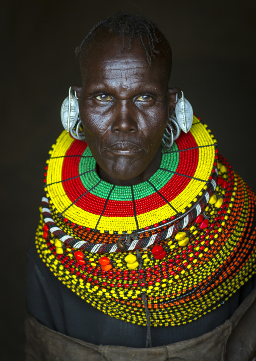Turkana tribe woman with huge necklaces and earrings, Turkana lake, Loiyangalani, Kenya