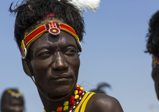 Turkana tribesman with headwear made of ostrich black feathers, Turkana lake, Loiyangalani, Kenya