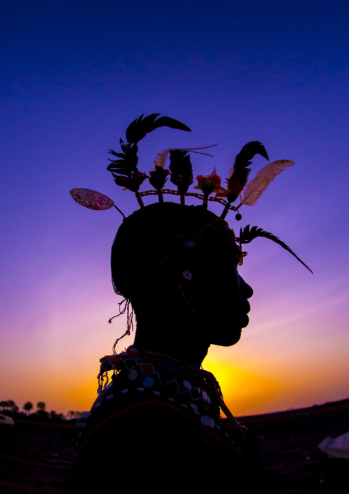 Silhouette of rendille warrior wearing traditional headwear, Turkana lake, Loiyangalani, Kenya