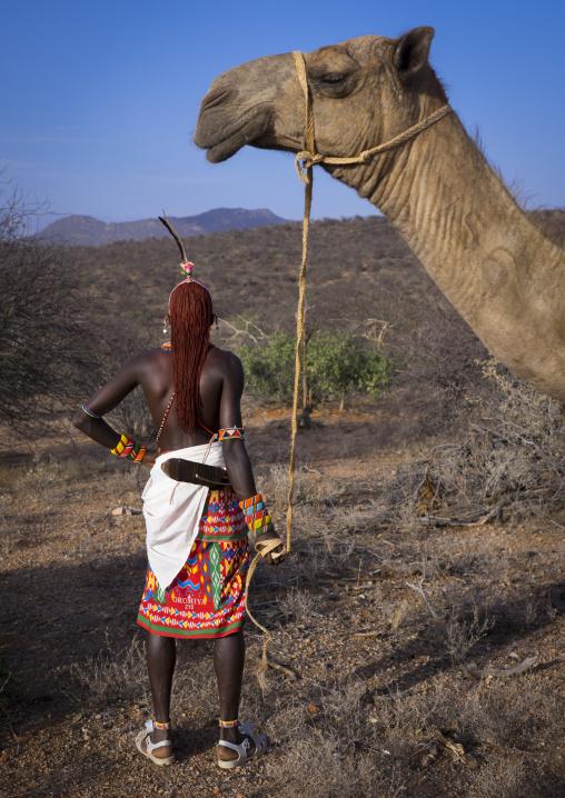 Rendille tribesman with his camel, Samburu county, Samburu national reserve, Kenya