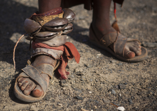 Turkana tribe woman in traditional footwear 'firestone' sandals, Turkana lake, Loiyangalani, Kenya