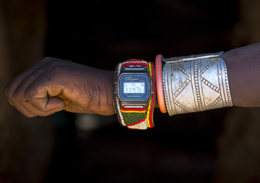 Rendille tribe warrior showing his watch decorated with beads, Marsabit district, Ngurunit, Kenya
