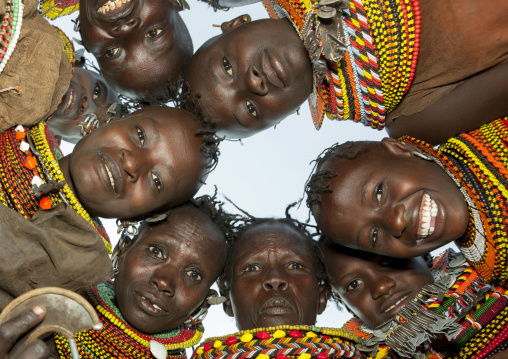 Turkana tribeswomen in circle looking down, Turkana lake, Loiyangalani, Kenya