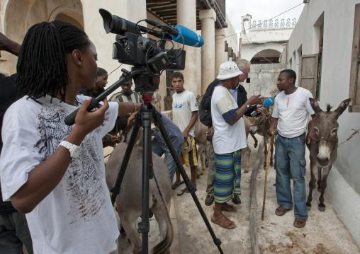 Reporter interviewing an inhabitant during Maulid festival, Lamu County, Lamu, Kenya