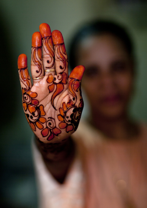 Unrecognizable person shows hand palm painted with henna and indigo, Lamu, Kenya