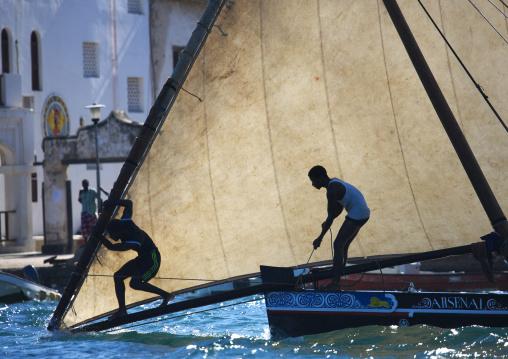 Arsenal dhow passing the lamu jetty during the race ,  Maulidi  festival , Lamu kenya