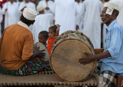 Man playing drums during maulidi, Lamu, Kenya