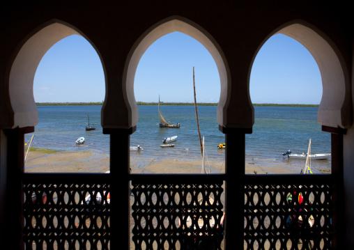 View on the sea and coast through arabic style window frame, Lamu, Kenya