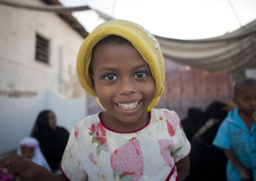 Mischievous girl smiling at camera, Lamu, Kenya