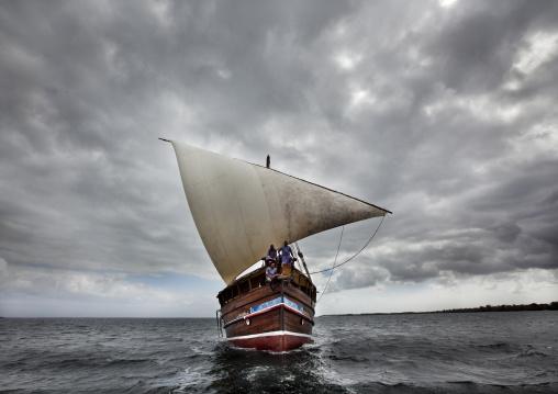 Swahilina dhow sailing near the coats of lamu, Kenya