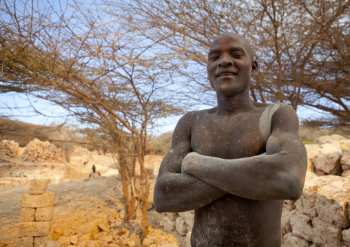 Dusty strong worker in coral stone quarry, On manda island, Lamu, Kenya