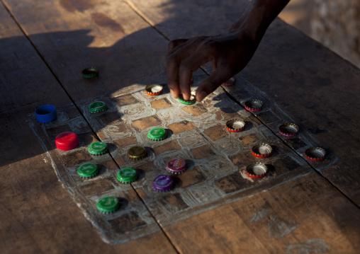 A chessboard made with bottle caps pawns, Lamu County, Lamu, Kenya