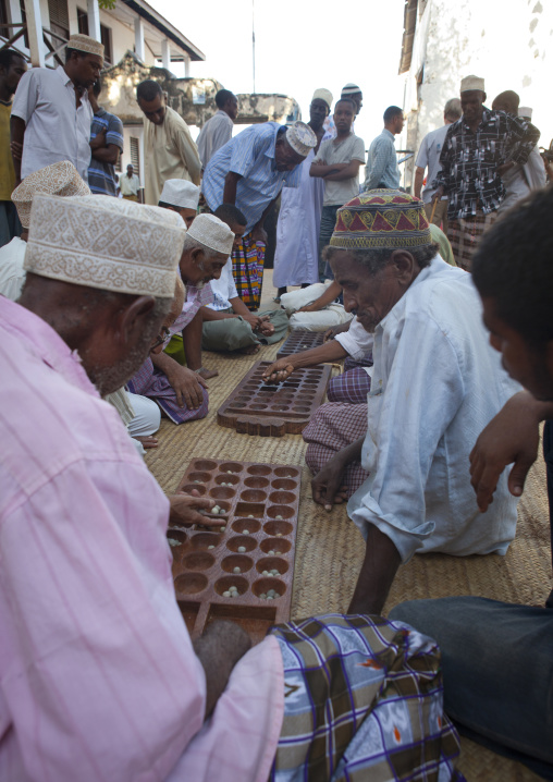 Players of bao during maulidi festival, Lamu, Kenya