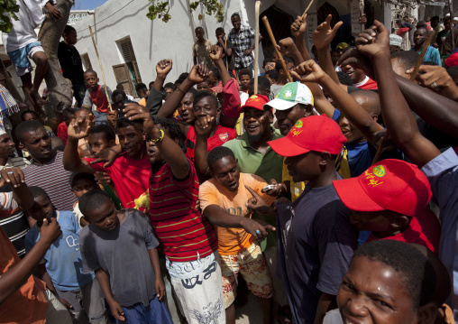 Crowd shouting when knows donkey riders' strike during donkey race, Maulidi festival, Lamu, Kenya