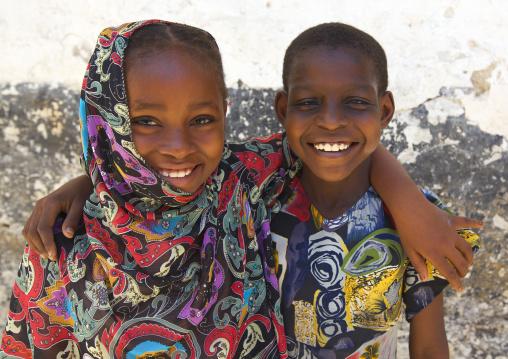 Teenage brother and sister holding each other, Cute brotherhood scene, Lamu, Kenya