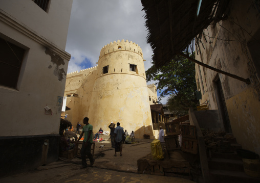 A view of lamu fort from shadowed street of lamu, Kenya