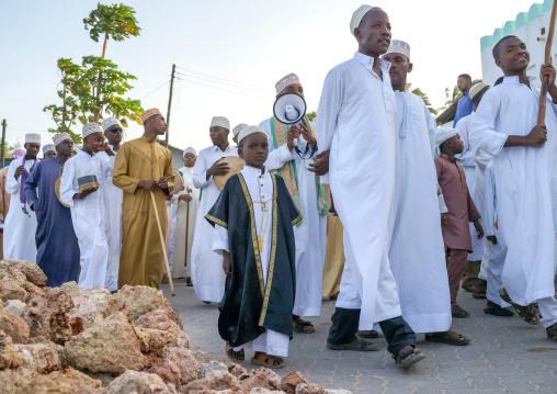 Sunni muslim people parading during the maulidi festivities in the street, Lamu county, Lamu town, Kenya