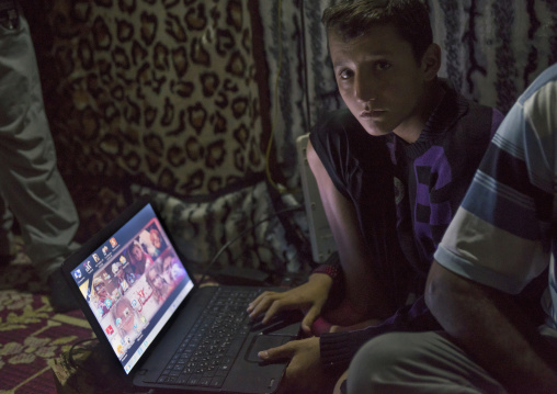 Yezedi Refugee From Sinjar Using A Computer, Duhok, Kurdistan, Iraq