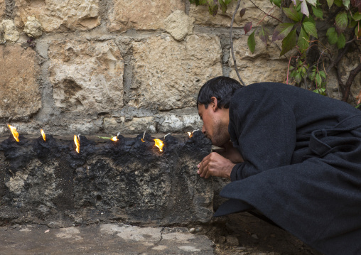 Yezedi Man Kissing The Sacred Fire, Lalesh Temple, Kurdistan, Iraq