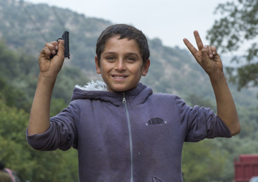 Yezedi Refugee From Sinjar Holding A Gun Toy, Lalesh Temple, Kurdistan, Iraq