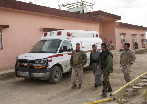 Kurdish Peshmergas On The Frontline In Front Of An Ambulance, Kirkuk, Kurdistan, Iraq