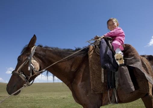 Young Girl Riding A Horse, Song Kol Lake Area, Kyrgyzstan