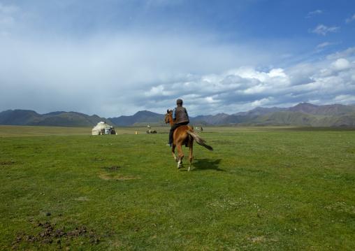 Boy Riding A Horse In The Steppe, Saralasaz Jailoo, Kyrgyzstan