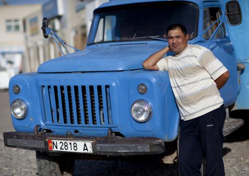 Man Leaning On The Hood Of A Truck, Kochkor, Kyrgyzstan