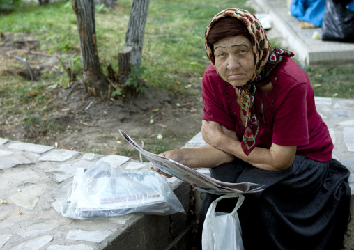 Old Veiled Woman Reading A Newspaper, Bishkek, Kyrgyzstan