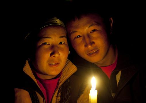 Couple Together Around A Candle, Jaman Echki Jailoo Village, Kyrgyzstan
