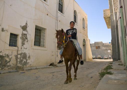 Man riding a horse in the medina, Tripolitania, Tripoli, Libya
