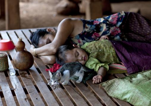 Bru minority mother and baby sleeping, Katou, Laos