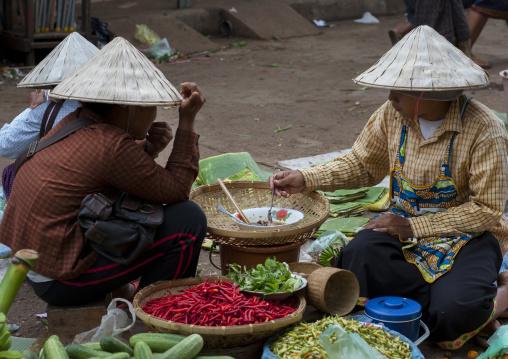 Women selling food on a market, Pakse, Laos