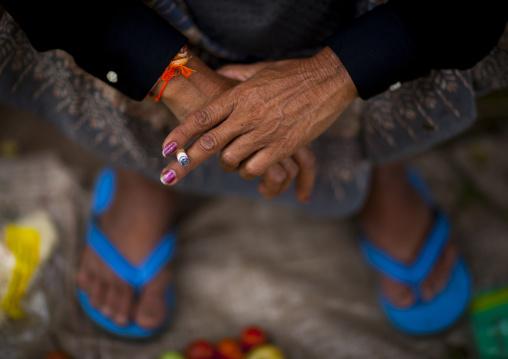 Woman smoking a cigarette, Pakse, Laos